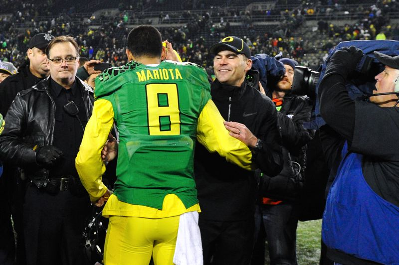 by: COURTESY OF MEG WILLIAMS - Oregon coach Mark Helfrich congratulates his quarterback, Marcus Mariota, moments after the Ducks pulled out a 36-35 Civil War victory Friday at Autzen Stadium.