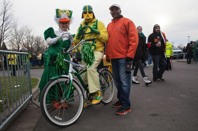 by: COURTESY OF MEG WILLIAMS - Oregon and Oregon State fans dress differently for the game.