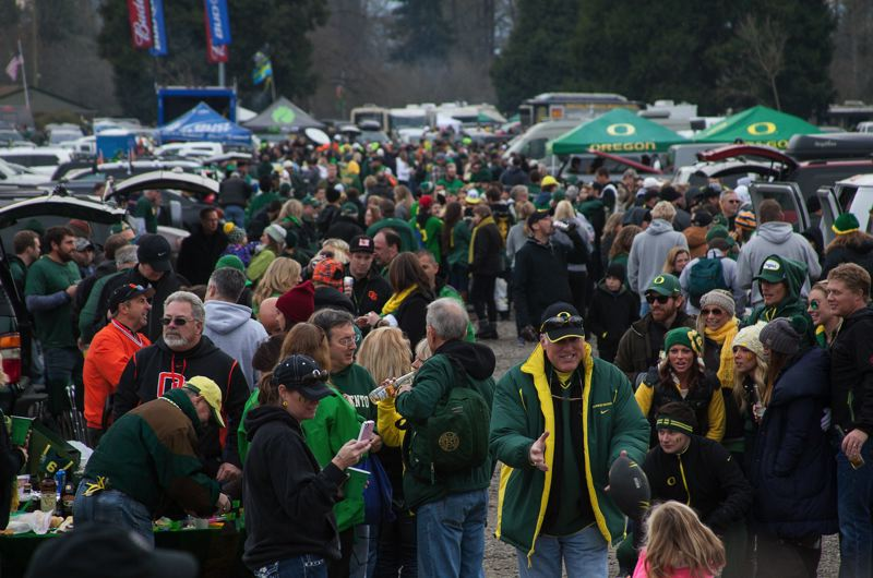 by: COURTESY OF MEG WILLIAMS - Tailgating draws a crowd before kickoff.