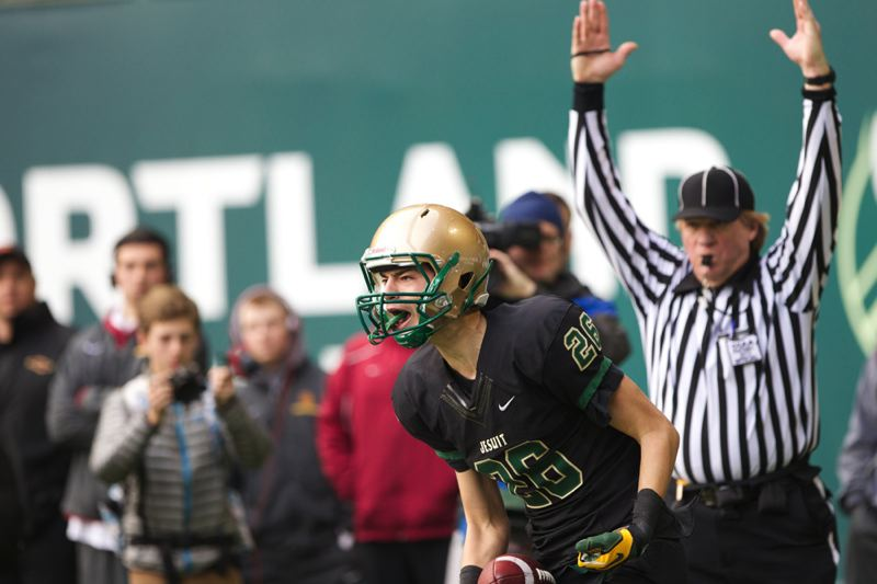 Jesuit Crusaders wide receiver Mitchell Powers reacts after scoring a touchdown  against the Canby Cougars.