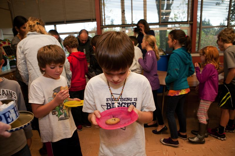 by: PHOTO COURTESY OF KATHARINE KIMBALL  - A third-grader at Rieke Elementary School prepares to sample a chocolate chip cookie baked with mealworms.