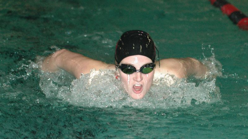 by: SANDY POST: FILE PHOTO - Sandys Hannah Gupton comes up for a breath during a 200 medley race last season.
