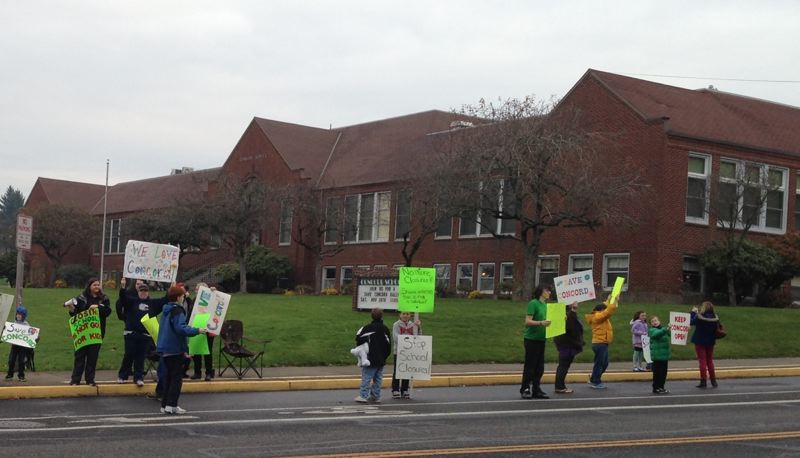 by: PHOTO COURTESY: SHELLY HAINES - Parents and neighbors rally against any proposed school closure at Concord Elementary School on Saturday, saying there should be a better way to balance the North Clackamas School District budget.