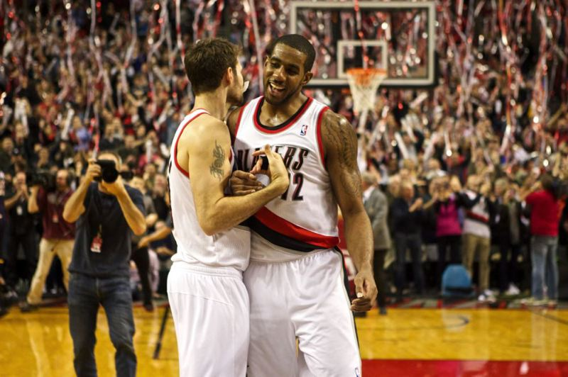 Trail Blazers leading scorer LaMarcus Aldridge (right) gets congratulations from Joel Freeland after Monday night's home victory over the Indiana Pacers.