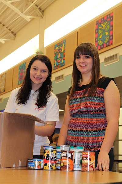 by: SPOKESMAN PHOTO: KATE HOOTS - Justine Cohen, left, and Jessica Small are organizing a community-wide food drive, with neighorhood pickup of canned good scheduled for Saturday.