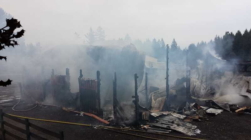 by: TVF&R - TVF&R and Newberg Fire personnel responded to a barn fire at a Parrett Mountain residence Friday between Wilsonville and Sherwood.