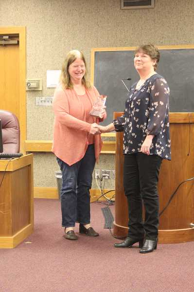 by: LINDSAY KEEFER - Mayor Kathy Figley (left) presented the Mary Tennant Award for Excellence in Public Service to Teresa Timmons at Nov. 25's Woodburn City Council meeting.