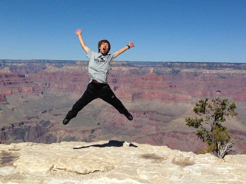 by: SUBMITTED PHOTO - Yuichi Tsuchida jumps for joy after seeing the Grand Canyon for the first time. The 21-year-old Japanese man saw a lot of country but returned home without a scratch and only a few scares.