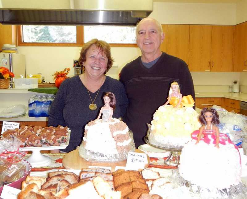 by: SUBMITTED - Brenda and Tony Perry baked for hours to bring pasties from England to the holiday craft fair. Kathie Halicki and Anne, Cole and Lauren Fiala of the Fiala Farms also contributed assorted breads and gingerbread boys respectively.