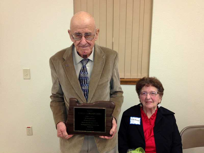 by: COURTESY PHOTOS - Helvetia resident Elmer Grossen, 92, has spent 65 years as a member of the Washington County Farm Bureau, having joined as a charter member when it formed in 1948. The group gave him a plaque at its annual meeting last month.