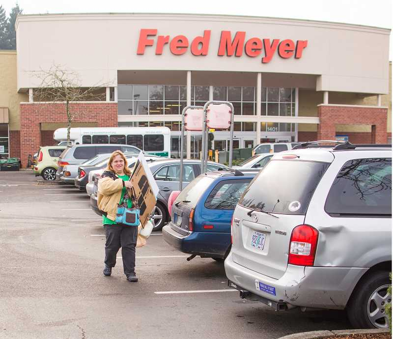 by: RAY HUGHEY - Cindy Carlson, of Woodburn, was in the Canby Fred Meyer parking lot at 3:30 a.m. Friday to be first in line when the store opened at 5 a.m.