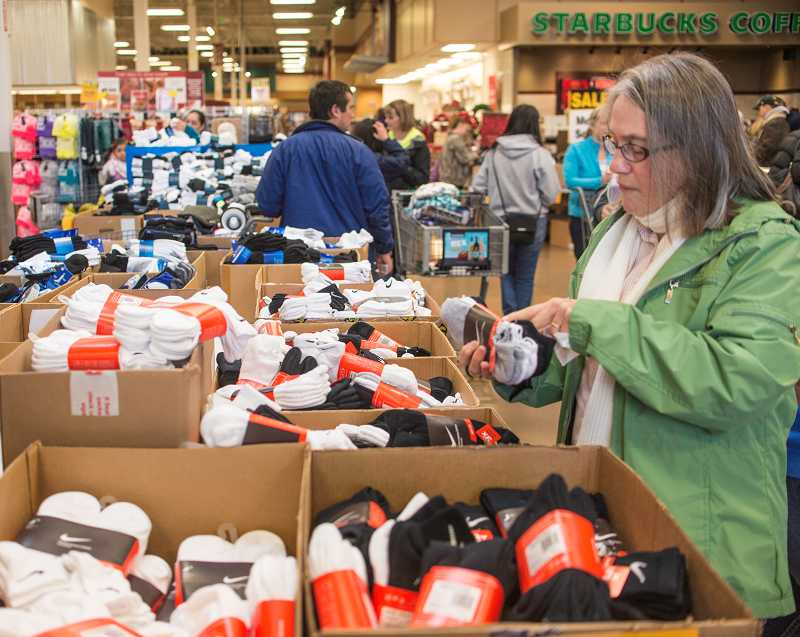 by: RAY HUGHEY - The sock bins at Fred Meyer were a popular target for Friday shoppers.