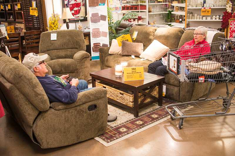by: RAY HUGHEY - Jim and Val Knodel had made themselves comfortable in a living Jim and Val Knodel had made themselves comfortable in a living room set they were considering.