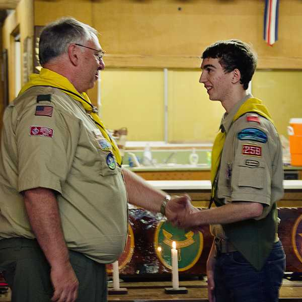 by: SUBMITTED PHOTO - Tom Kratzer, right, accepts congratulations from former Troop 258 Scoutmaster Tom Brandt after receiving his Eagle Scout award.