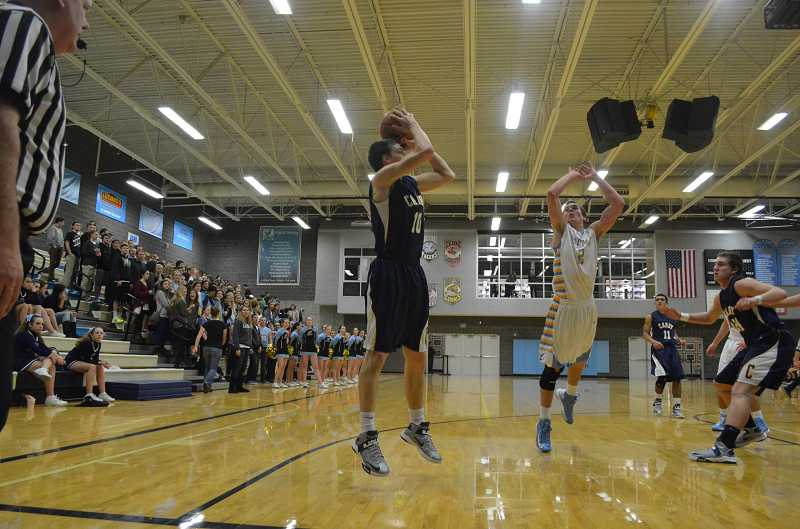 by: JEFF GOODMAN / FILE - Jace Cates (left), shown during last year's league game at Lakeridge, will have an expanded role on the Canby boys basketball team this season. The junior played with the I-5 Elite club squad during the offseason and has improved at both ends of the floor.
