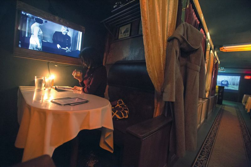 by: TRIBUNE PHOTO: JONATHAN HOUSE - A patron enjoys some silent time at the Modern Man bar, which sits below its namesake barbershop on North Mississippi Avenue.