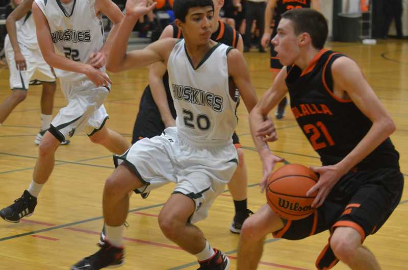 by: JEFF GOODMAN / FILE - Cuautli Verastegui (left) and the North Marion boys basketball team are in the hunt for their first playoff appearance since 2010-11. Above, Verastegui defends Ryan Potter in last year's home game against Molalla.