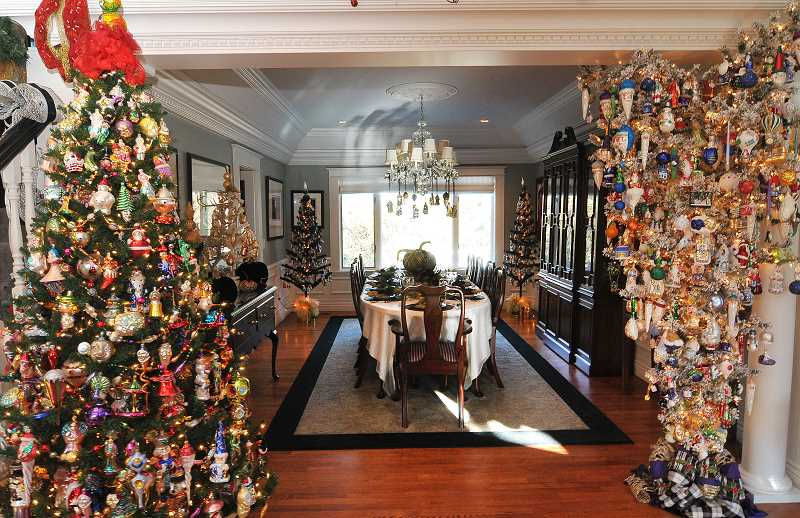 by: STAFF PHOTOS: VERN UYETAKE - Nancy Stallings home features more than 30 full-size trees and a table already set for Christmas dinner.