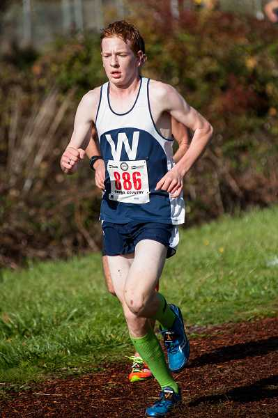 by: GREG ARTMAN / FILE - Kody Wilde and the Wilsonville boys cross-country team won a district title this season. The Wildcats have won four NWOC championships in a row.