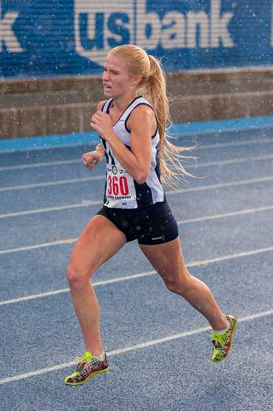 by: GREG ARTMAN / FILE - District champion Taryn Rawlings earned the fourth top-10 state finish of her stellar high school cross-country career while leading the Wilsonville girls this year.