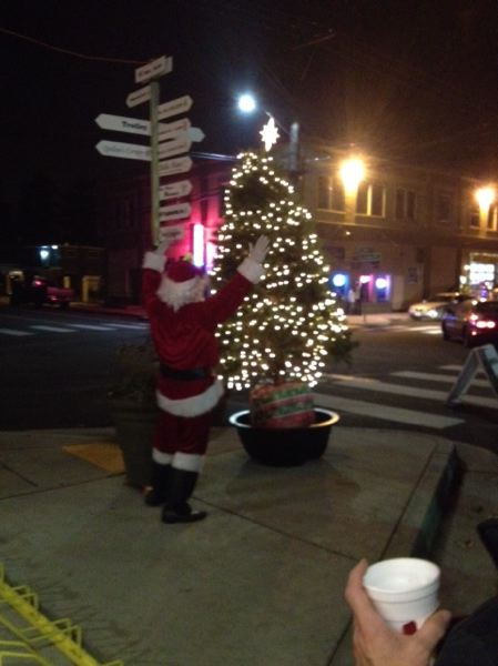 by: PHOTO COURTESY: MAUREEN NOTT - Santa visits to help with Oak Grove's tree lighting last Saturday.