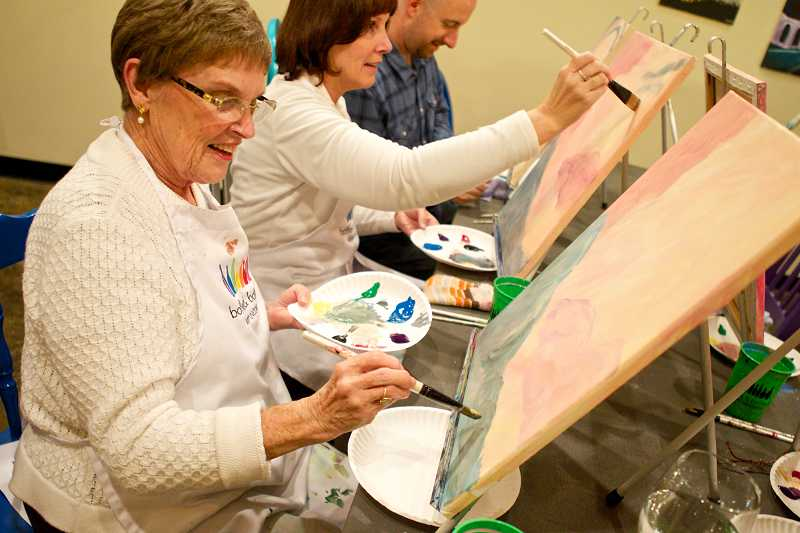 by: TIMES PHOTO: JAIME VALDEZ - Bev Olson of Forest Grove works on her painting during a pop-up art class.