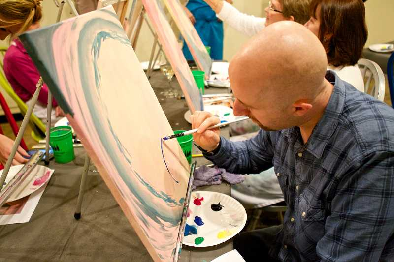 by: TIMES PHOTO: JAIME VALDEZ - Raun Koffman of Southwest Portland works on his painting during a pop-up art class.