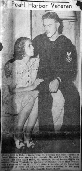 by: TIMES PHOTO: JONATHAN HOUSE - A newspaper clip shows World War II veteran Chief Petty Officer Bob Westerberg, U.S. Navy, with his mother after he returned home from the attack on Pearl Harbor.