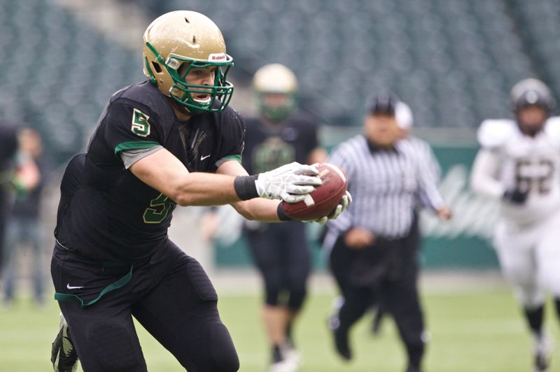 by: PAMPLIN MEDIA GROUP: JAIME VALDEZ - Jesuit tight end Christian Martinek, one of the Metro League players of the year, has been a reliable target for sophomore quarterback Eric Restic in the passing game during the Class 6A playoffs.