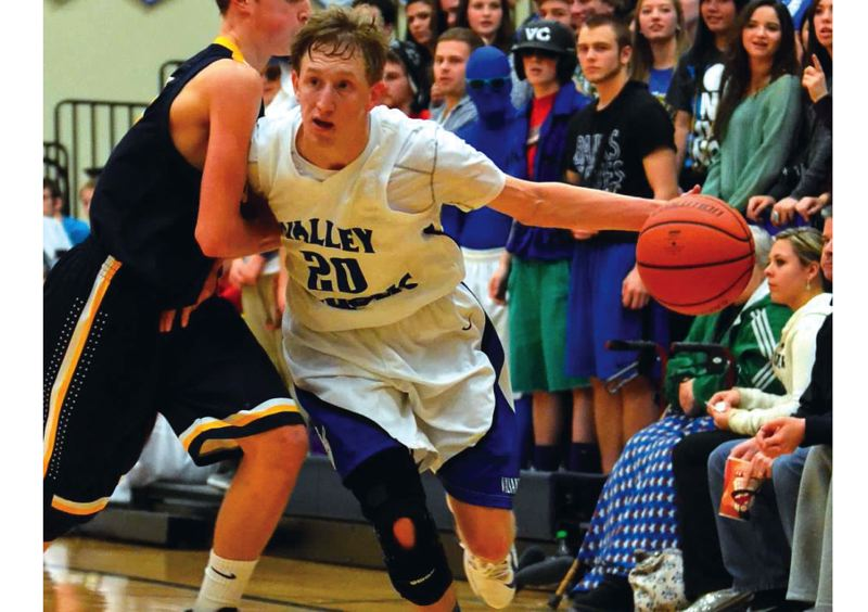 by: TIMES FILE PHOTO - Valley Catholic senior shooting guard Carter Buuck will return in January for the start of Lewis and Clark League play.