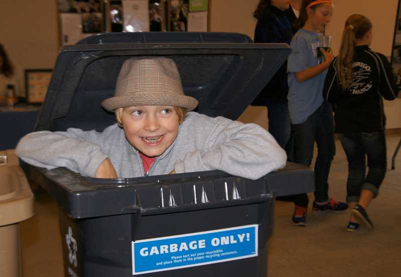 by: SUBMITTED PHOTO - Hallinan Elementary School student Campbell Brown pops up during a November event marking America Recycles Day.