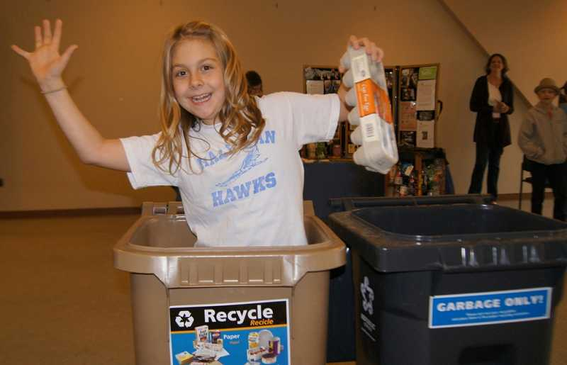 by: SUBMITTED PHOTO - Green Team member Anna Seely offered a recycling demonstration at an event last month.