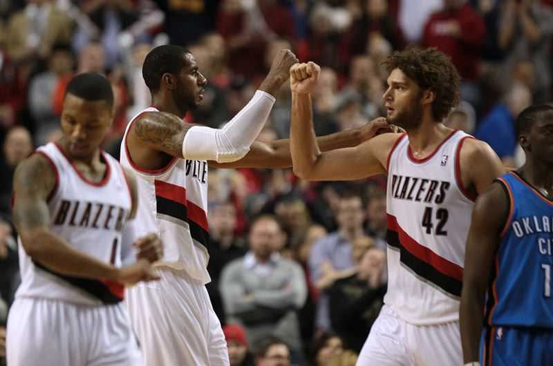 by: TRIBUNE PHOTO: JONATHAN HOUSE - Robin Lopez (right) and LaMarcus Aldridge share congratulations after a play in the Trail Blazers' victory over Oklahoma City on Wednesday night at Moda Center.