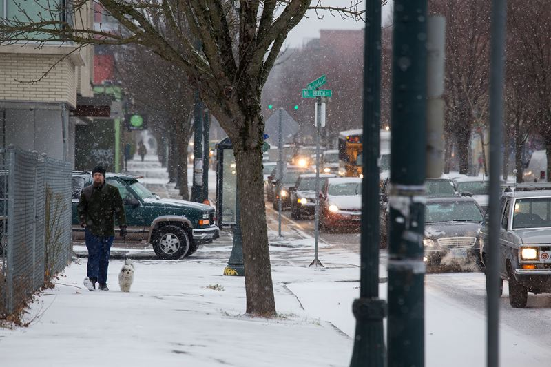 by: TRIBUNE PHOTO: JONATHAN HOUSE - Friday morning's snow caused traffic to back up on Northeast Martin Luther King Jr. Boulevard as a quarter-inch fell in parts of Portland.