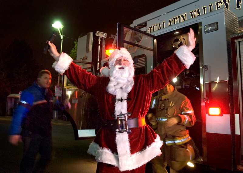 Santa will arrive aboard a Tualatin Valley Fire & Rescue fire engine to light Tigard's Christmas tree at Pacific Highway and Main Street on Friday night.