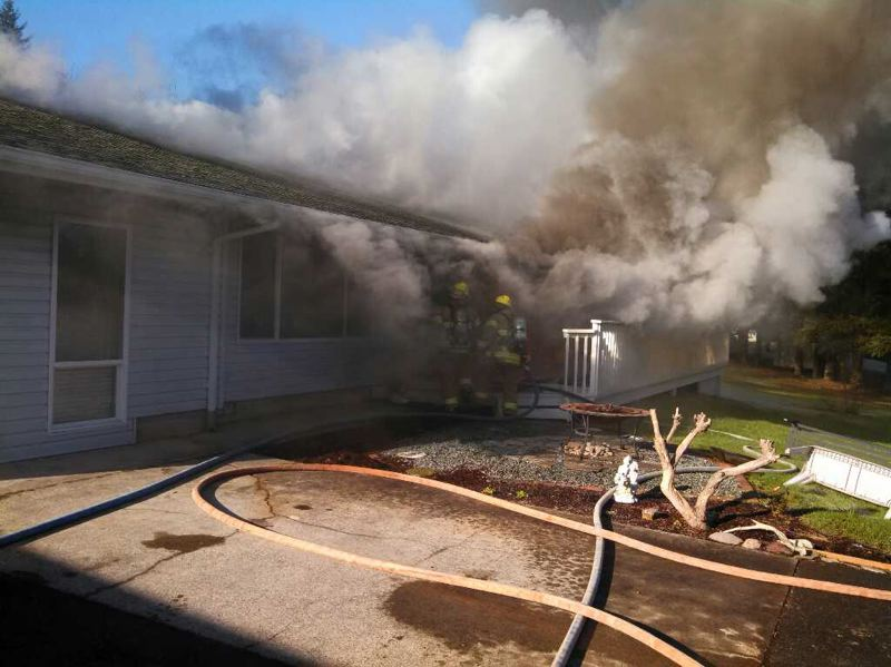 by: SUBMITTED PHOTO - In a statement released by Columbia River Fire & Rescue, CRFR Chief Jay Tappan credited the Yankton homeowners quick actions and working smoke alarm system for preventing any serious injuries.