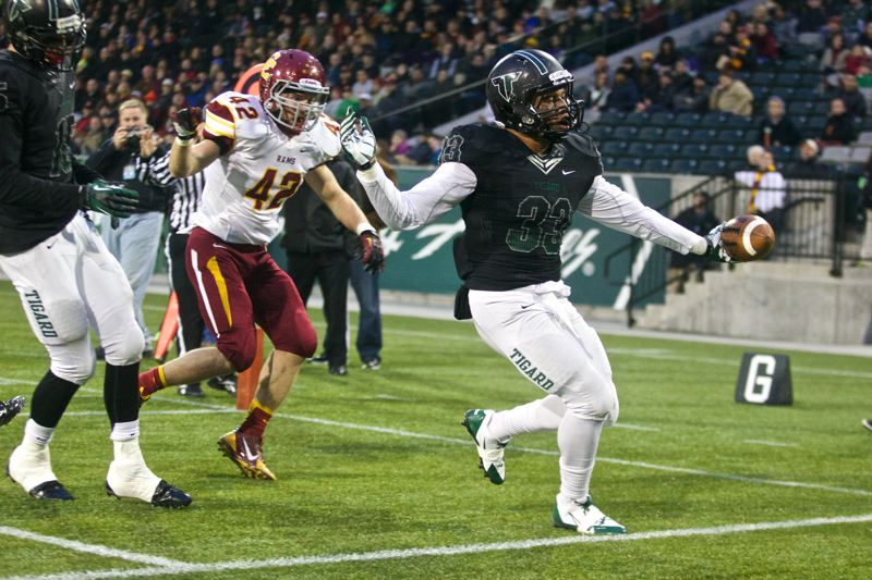 by: JAIME VALDEZ - TIGER TOUCHDOWN -- Tigard senior fullback A.J. Hotchkins (33) reaches the end zone for one of his two touchdowns in Saturday's state playoff semifinal game played at Jeld-Wen Field.