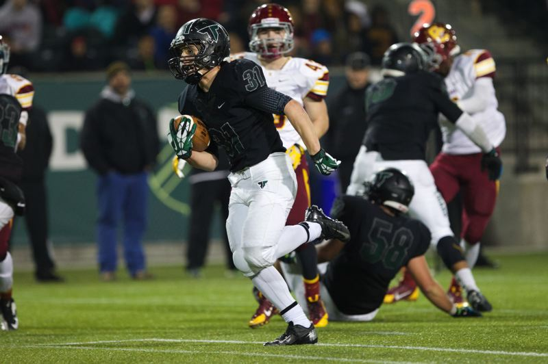 by: JAIME VALDEZ - TD TYLER -- Tigard High School junior running back Tyler Walker scored three rushing touchdowns for the Tigers in Saturday's Class 6A state playoff semifinal contest.