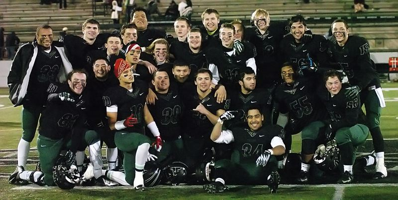 by: DAN BROOD - SUPER SENIORS -- The seniors on the Tigard High School football team gather together following their win over North Medford in a Class 6A state playoff quarterfinal game.