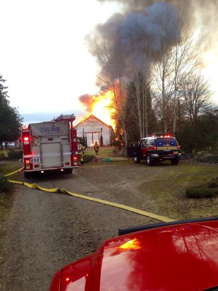 by: COURTESY TUALATIN VALLEY FIRE AND RESCUE - This barn and residence off Grahams Ferry Road in northwest Wilsonville caught fire this afternoon.