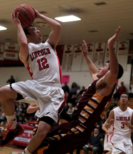 by: TRIBUNE PHOTO: JONATHAN HOUSE - Lincoln's Matt Peeler gets contact on the shot against Forest Grove.