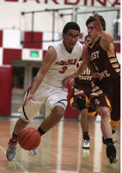 by: TRIBUNE PHOTO: JONATHAN HOUSE - Lincoln's Jonah Pemberton drives on the Forest Grove defense.