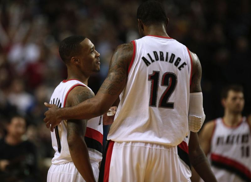 by: TRIBUNE FILE PHOTO: JONATHAN HOUSE - Damian Lillard (left), LaMarcus Aldridge and the Trail Blazers starters were able to take the night off early Friday in a rout of the Utah Jazz at Moda Center.