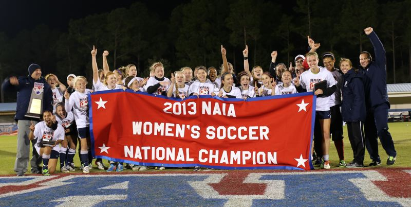 by: COURTESY OF NAIA - Concordia University's women's soccer team celebrates its national field after winning the title game 1-0 over Westmont College Saturday night at Orange Beach, Ala.