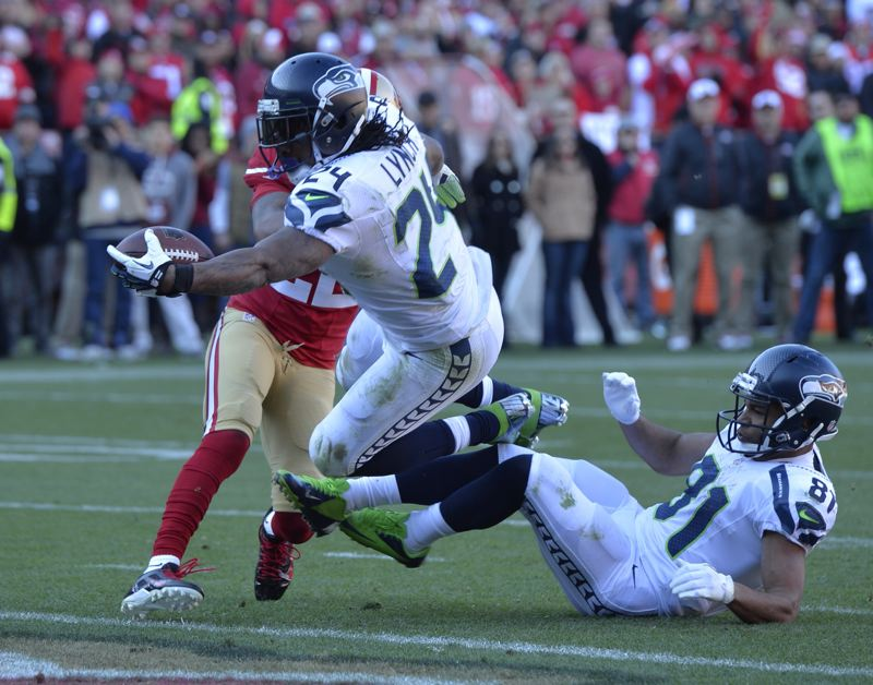 by: COURTESY OF MICHAEL WORKMAN - Marshawn Lynch scores for the Seattle Seahawks in their 19-17 loss Sunday at San Francisco.