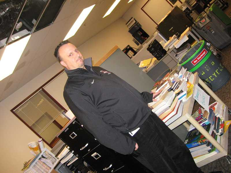 by: RAY PITZ - Sherwood High School Principal Ken Bell stands in front of damaged books in a teacher work space Monday afternoon. The school was closed Monday due to water damage caused by broken pipes along with a lack of heat in some classrooms.