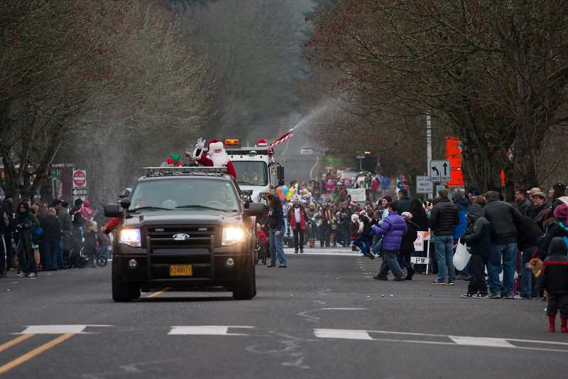 by: SUBMITTED PHOTO - Lots of fun will happen Saturday in the historic Willamette district. Dont miss the Ugly Holiday Sweater Dash at 9 a.m. and the annual parade, which begins at 10 a.m.