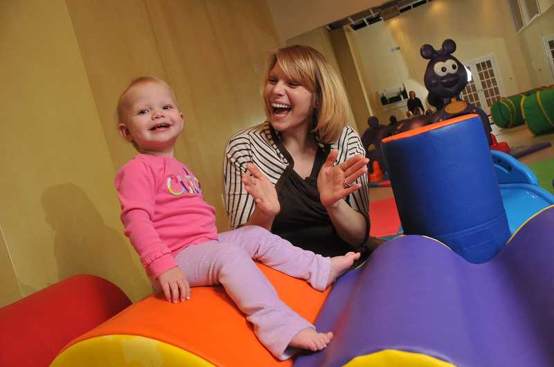 by: STAFF PHOTOS: VERN UYETAKE  - Gina Candland and her daughter Fiona play in one of the studios at Moxie Dance Theatre.