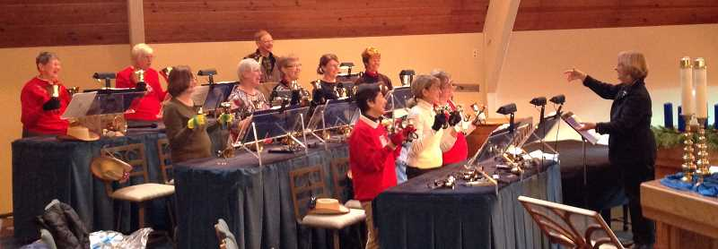 by: SUBMITTED PHOTO: LARRY ZIEGLER - Linda Woods directs her church handbell choir at a recent rehearsal. She wants her ringers to be in top form for Sundays special Christmas program.