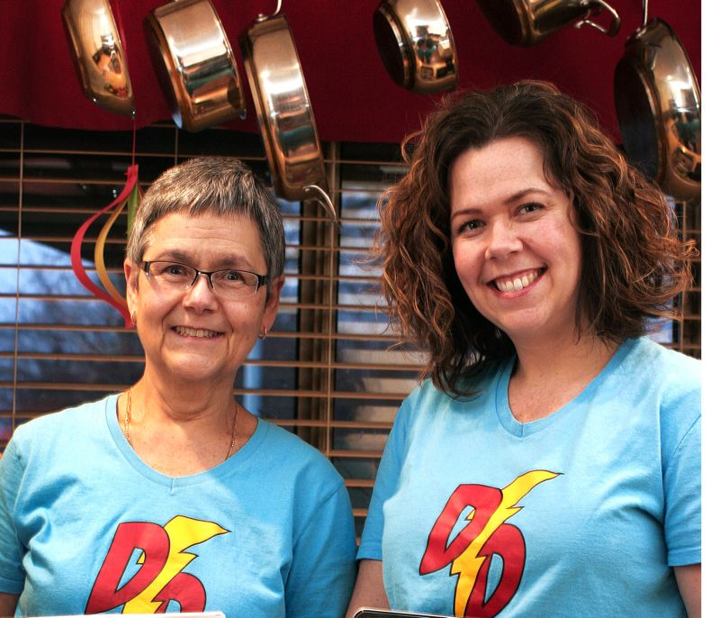 by: OUTLOOK PHOTO: JIM CLARK - Judy Hart (left) and Michele Es-Sahb are the mother/daughter duo behind Dinner Dynamo, a website designed to help shoppers save money at the grocery store by matching meal plans with sale ads.